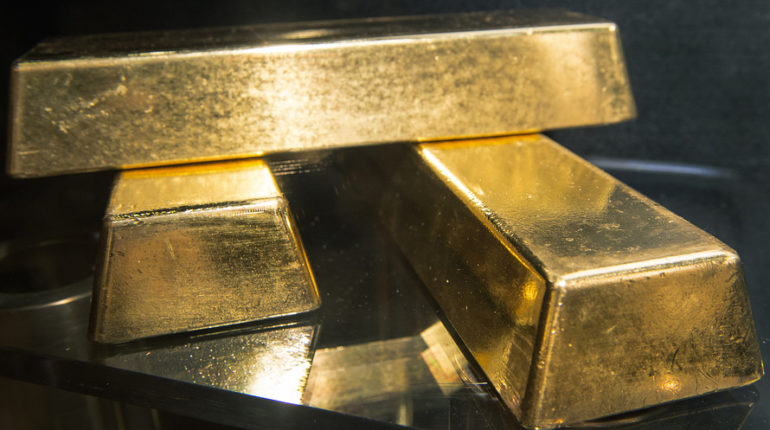 GOLD SELLS OFF MODERATELY, THEN RECOVERS, AFTER U.S. RATE CUT