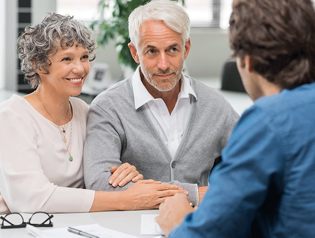 Mature couple talking to businessman, reasons to work with Priority Gold.
