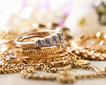 pile of gold jewelery