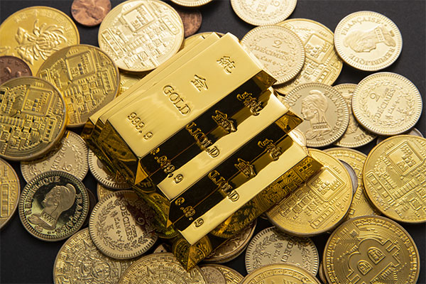 A stack of gold bars on top of gold coins.